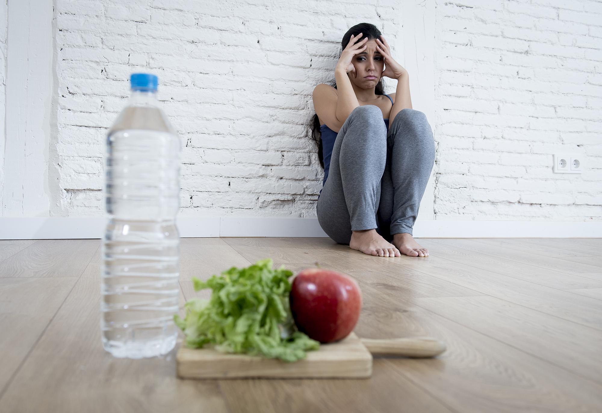 Woman Looking at Food