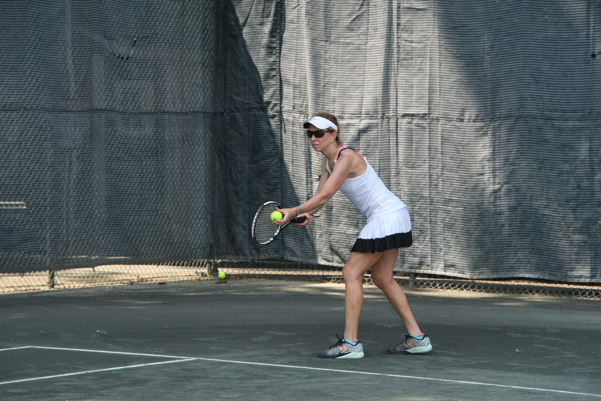 Displaying A tennis player readies her serve.JPG